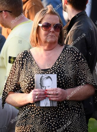 Mourner holding a photograph of Keith Flint