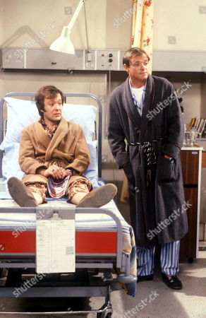 Stock Photo of 'Only When I Laugh' TV - 1979 - featuring Norman, as played by Christopher Strauli, and Figgis, as played by James Bolam.