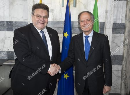 Italian Minister for Foreign Affairs Enzo Moavero Milanesi (R) shakes hands with his Lithuanian counterpart Linas Antanas Linkevicius during their meeting at Farnesina Palace in Rome, Italy, 29 March 2019.