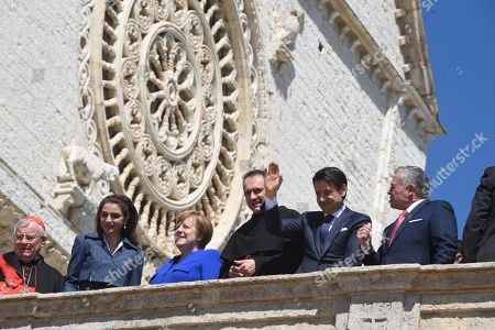 The King of Jordan, Abdullah II (R), with German Chancellor Angela Merkel (3-L), Italian Premier Giuseppe Conte (2-R) and Queen Rania Al-Abdullah (2-L) of Jordan, during the Lamp of Peace of Saint Francis award ceremony, at the Basilica of Saint Francis in Assisi, Italy, 29 March 2019. The Catholic prize for promoting 'peaceful coexistence among peoples' in 2019 is awarded to Jordanian King Abdullah II. Chancellor Merkel received the prize last year for her 'reconciliation efforts in favor of the peaceful coexistence of peoples.