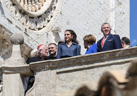 The King of Jordan, Abdullah II (R), with Queen Rania Al-Abdullah (C), during the Lamp of Peace of Saint Francis award ceremony, at the Basilica of Saint Francis in Assisi, Italy, 29 March 2019. The Catholic prize for promoting 'peaceful coexistence among peoples' in 2019 is awarded to Jordanian King Abdullah II. Chancellor Merkel received the prize last year for her 'reconciliation efforts in favor of the peaceful coexistence of peoples.