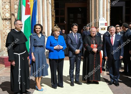 The King of Jordan, Abdullah II (R), with German Chancellor Angela Merkel (3-L), Italian Premier Giuseppe Conte (3-R) and Queen Rania Al-Abdullah (2-L) pose for a group photo, during the Lamp of Peace of Saint Francis award ceremony, at the Basilica of Saint Francis in Assisi, Italy, 29 March 2019. The Catholic prize for promoting 'peaceful coexistence among peoples' in 2019 is awarded to Jordanian King Abdullah II. Chancellor Merkel received the prize last year for her 'reconciliation efforts in favor of the peaceful coexistence of peoples.