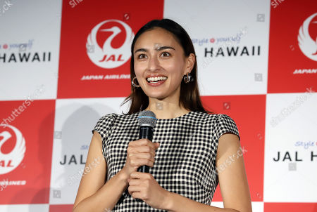 Stock Image of Japanese-American model Jun Hasegawa attends an event of Japan Airlines' tourism promotion to Hawaii with Hilton Grand Vacations