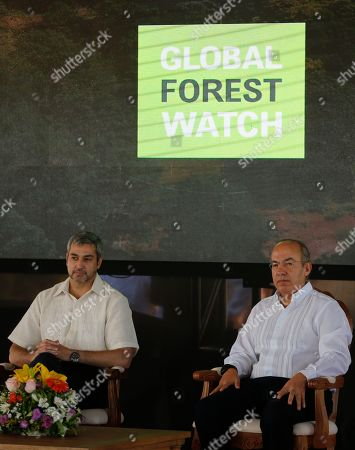 Stock Image of Former Mexican President Felipe Calderon, right, advisor to the global World Resources Institute NGO, attends official ceremony with Paraguay's President Mario Abdo Benitez in Asuncion, Paraguay, . Calderon signed a reforestation and environmental resources agreement with Paraguay