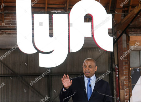 """Stock Picture of Anthony Foxx, chief policy officer of Lyft Inc., speak during a ceremonial opening bell in Los Angeles, . On Friday the San Francisco company's stock will begin trading on the Nasdaq exchange under the ticker symbol """"LYFT"""