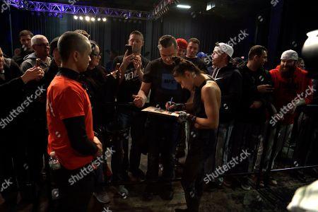 Karolina Kowalkiewicz, No. 6 UFC women's strawweight, signs an autograph in Philadelphia. She is scheduled to fight No. 8 UFC women's strawweight Michelle Waterson on March 30 in Philadelphia