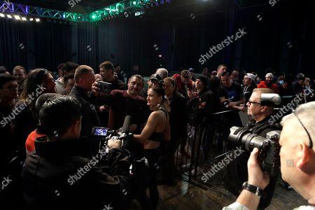 Karolina Kowalkiewicz, No. 6 UFC women's strawweight, poses with a fan in Philadelphia. She is scheduled to fight No. 8 UFC women's strawweight Michelle Waterson on March 30 in Philadelphia