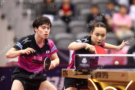 ITO Mima (R) of Japan in action with teammate Morizono Masataka (L) during the mixed table tennis doubles Semifinals match against LIN Yun-Juland Cheng I-Ching of Taiwan (not pictured) at the ITTF World Tour Qatar Open in Doha, 29 March 2019.