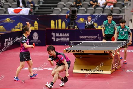 ITO Mima (L) of Japan reacts with teammate Morizono Masataka (2nd L) during the mixed table tennis doubles Semifinals match against LIN Yun-Juland CHENG I-Ching (R) of Taiwan (not pictured) at the ITTF World Tour Qatar Open in Doha, 29 March 2019.