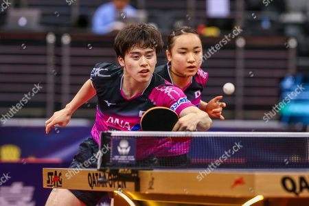 Morizono Masataka (L) of Japan in action with teammate ITO Mima (R) during the mixed table tennis doubles Semifinals match against LIN Yun-Juland Cheng I-Ching of Taiwan (not pictured) at the ITTF World Tour Qatar Open in Doha, 29 March 2019.