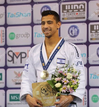 Tal Flicker of Israel poses with his gold medal on the podium after winning the men's -66kg category at the Tbilisi Judo Grand Prix 2019 in Tbilisi, Georgia, 29 March 2019.