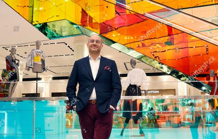 Saks Fifth Avenue President Marc Metrick poses for a photograph inside the company's flagship Fifth Avenue store, in New York. A company insider, the 45-year-old Metrick aims to reinvent the department store experience to bring theater to luxury shopping at a time when shoppers can buy their designer handbags online
