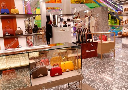 Stock Picture of Colorful handbags are displayed at Saks Fifth Avenue's flagship midtown Manhattan store, in New York. Company insider and president Marc Metrick aims to reinvent the department store experience, namely to bring theater to luxury shopping at a time when shoppers can buy their designer handbags online