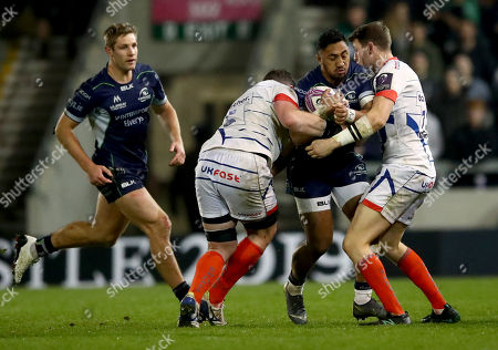 Stock Picture of Sale Sharks vs Connacht. Sale Sharks's Sam James and James Phillips tackle Bundee Aki of Connacht