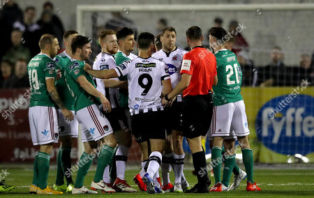Stock Photo of Dundalk vs Cork City. Referee Paul McLoughlin surrounded by players from both teams