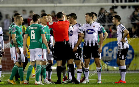 Dundalk vs Cork City. Referee Paul McLoughlin surrounded by players from both teams