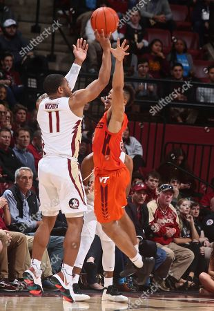 David Nichols, Wabissa Bede. Florida State guard David Nichols (11) attempts a 3-point shot over the defense of Virginia Tech guard Wabissa Bede (3) in the first half of an NCAA college basketball game in Tallahassee, Fla., . Florida State won 73-64 in overtime