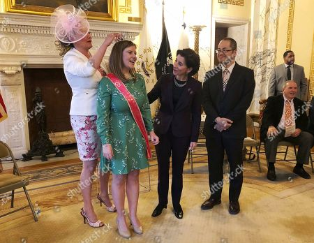 Gina Raimondo, Yasuhiro Yamauchi. Democratic Gov. Gina Raimondo, second from right, congratulates Rhode Island's 2019 Cherry Blossom Princess Margaret Rogers as Ewa Dzwierzynski, left, adjusts her crown during a ceremony, at the State House, in Providence R.I. Yasuhiro Yamauchi, right, of the Consulate-General of Japan in Boston, attended the ceremony to congratulate Rogers, who will represent the state in Washington, D.C., at the National Cherry Blossom Festival. Cherry trees have been planted in several Blackstone Valley municipalities to symbolize the friendship between the U.S. and Japan