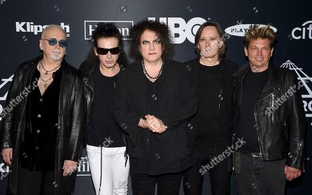 Reeves Gabrels, Simon Gallup, Robert Smith, Roger O'Donnell, Jason Cooper. Reeves Gabrels, from left, Simon Gallup, Robert Smith, Roger O'Donnell and Jason Cooper, of The Cure, arrive at the Rock & Roll Hall of Fame induction ceremony at the Barclays Center, in New York