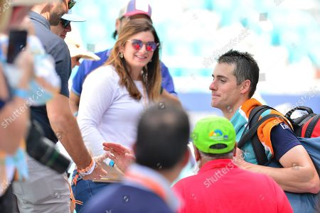 John Isner, of the United States talk to his wife Madison McKinley Isner, after his match with Felix Auger Aliassime, of Canada, during a semifinal match at the Miami Open Presented by Itau professional tennis tournament, played at the Hardrock Stadium in Miami Gardens, Florida