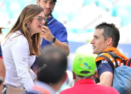 Stock Picture of John Isner, of the United States talk to his wife Madison McKinley Isner, after his match with Felix Auger Aliassime, of Canada, during a semifinal match at the Miami Open Presented by Itau professional tennis tournament, played at the Hardrock Stadium in Miami Gardens, Florida