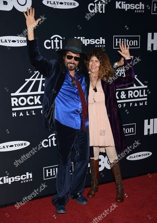 Mike Campbell, Marcie Campbell. Mike Campbell, left, and Marcie Campbell arrive at the Rock & Roll Hall of Fame induction ceremony at the Barclays Center, in New York