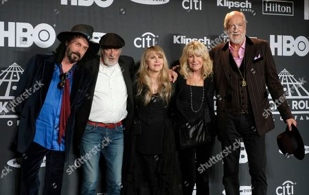 Stevie Nicks, Mike Campbell, John McVie, Christine McVie, Mick Fleetwood. Inductee Stevie Nicks, center, poses with from left, Mike Campbell, xxx, Christine McVie and Mick Fleetwood in the press room at the Rock & Roll Hall of Fame induction ceremony at the Barclays Center, in New York