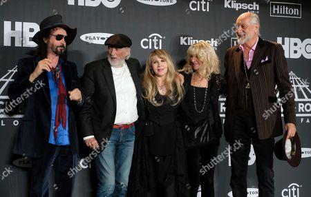 Stevie Nicks, Mike Campbell, John McVie, Christine McVie, Mick Fleetwood. Inductee Stevie Nicks, center, poses with from left, Mike Campbell, John McVie, Christine McVie and Mick Fleetwood in the press room at the Rock & Roll Hall of Fame induction ceremony at the Barclays Center, in New York