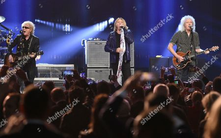 Ian Hunter, Joe Elliott, Brian May. Ian Hunter, from left, inductee Joe Elliott, of Def Leppard, and Brian May, of Queen, perform at the Rock & Roll Hall of Fame induction ceremony at the Barclays Center, in New York