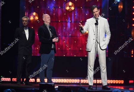 Philip Selway, Ed O'Brien, David Byrne. Inductees Ed O'Brien, right, and Philip Selway, center, of Radiohead, accept a trophy as presenter David Byrne looks on at the Rock & Roll Hall of Fame induction ceremony at the Barclays Center, in New York