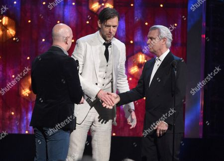 David Byrne, Philip Selway, Ed O'Brien. David Byrne, right, presents a trophy to inductees Philip Selway, from left, and Ed O'Brien, of Radiohead, at the Rock & Roll Hall of Fame induction ceremony at the Barclays Center, in New York