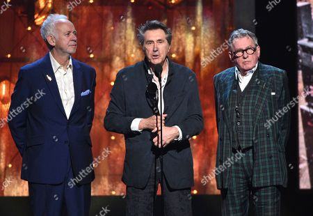 Phil Manzanera, Bryan Ferry, Andy Mackay. Inductees Phil Manzanera, from left, Bryan Ferry and Andy Mackay, of Roxy Music, accept a trophy at the Rock & Roll Hall of Fame induction ceremony at the Barclays Center, in New York