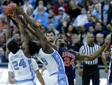 Auburn's Anfernee McLemore, right, reaches for a rebound along with North Carolina's Kenny Williams, left, and Nassir Little during the first half of a men's NCAA tournament college basketball Midwest Regional semifinal game, in Kansas City, Mo