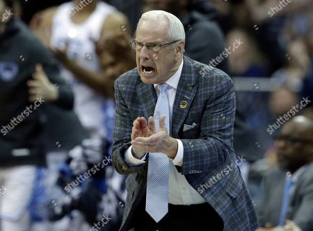 North Carolina head coach Roy Williams yells from the sidelines during the second half of a men's NCAA tournament college basketball Midwest Regional semifinal game against Auburn, in Kansas City, Mo