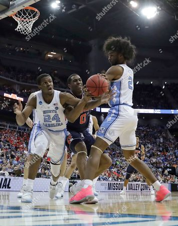 Auburn's Horace Spencer (0) reaches for the ball between North Carolina's Kenny Williams (24) and Coby White during the second half of a men's NCAA tournament college basketball Midwest Regional semifinal game, in Kansas City, Mo
