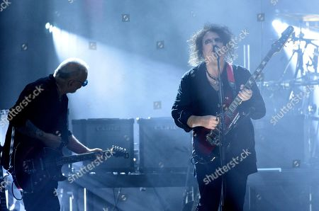 Reeves Gabrels, Robert Smith. Inductees Reeves Gabrels, left, and Robert Smith, of The Cure, perform at the Rock & Roll Hall of Fame induction ceremony at the Barclays Center, in New York