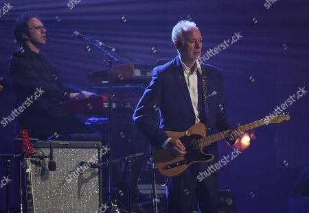 Stock Photo of Andy Mackay, of Roxy Music, performs at the Rock & Roll Hall of Fame induction ceremony at the Barclays Center, in New York