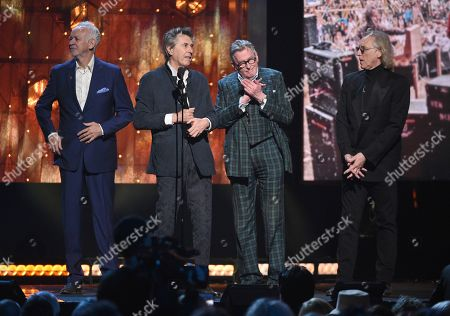 Phil Manzanera, Bryan Ferry, Andy Mackay, Eddie Jobson. Inductees Phil Manzanera, from left, Bryan Ferry, Andy Mackay and Eddie Jobson, of Roxy Music, accept a trophy at the Rock & Roll Hall of Fame induction ceremony at the Barclays Center, in New York