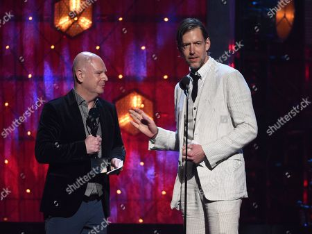 Ed O'Brien, Philip Selway. Inductees Ed O'Brien, right, and Philip Selway, of Radiohead, accept a trophy at the Rock & Roll Hall of Fame induction ceremony at the Barclays Center, in New York
