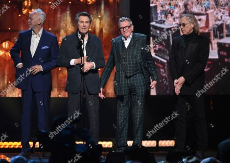 Stock Image of Phil Manzanera, Bryan Ferry, Andy Mackay, Eddie Jobson. Inductees Phil Manzanera, from left, Bryan Ferry, Andy Mackay and Eddie Jobson, of Roxy Music, accept a trophy at the Rock & Roll Hall of Fame induction ceremony at the Barclays Center, in New York
