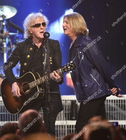 Stock Picture of Joe Elliott, Ian Hunter. Ian Hunter, left, and inductee Joe Elliott, of Def Leppard, perform at the Rock & Roll Hall of Fame induction ceremony at the Barclays Center, in New York