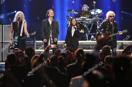 Stock Photo of Rick Savage, Colin Blunstone, Susanna Hoffs, Ian Hunter. Inductee Rick Savage, of Def Leppard, from left, inductee Colin Blunstone, of The Zombies, Susanna Hoffs and Ian Hunter perform at the Rock & Roll Hall of Fame induction ceremony at the Barclays Center, in New York