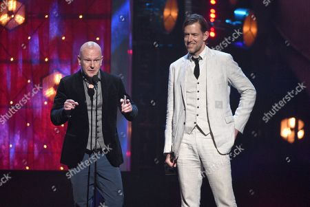 Philip Selway, Ed O'Brien. Inductees Ed O'Brien, right, and Philip Selway, of Radiohead, accept a trophy at the Rock & Roll Hall of Fame induction ceremony at the Barclays Center, in New York
