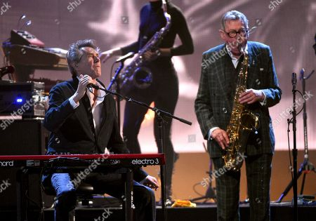Bryan Ferry, Andy Mackay. Inductees Bryan Ferry, left, and Andy Mackay, of Roxy Music, perform at the Rock & Roll Hall of Fame induction ceremony at the Barclays Center, in New York