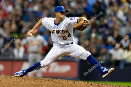 Stock Photo of Milwaukee Brewers relief pitcher Taylor Williams #54 delivers a pitch during the Major League Baseball game between the Milwaukee Brewers and the St. Louis Cardinals at Miller Park in Milwaukee, WI