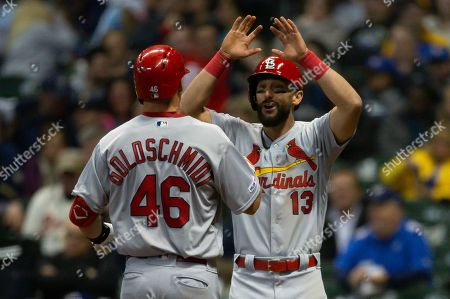 St. Louis Cardinals first baseman Matt Carpenter #13 congratulates St. Louis Cardinals first baseman Paul Goldschmidt #46 on his third home run of the game during the Major League Baseball game between the Milwaukee Brewers and the St. Louis Cardinals at Miller Park in Milwaukee, WI
