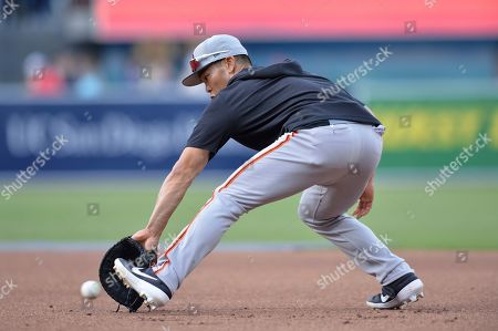 San Francisco Giants' Connor Joe fields a ground ball during batting practice before the baseball game against the San Diego Padres, in San Diego