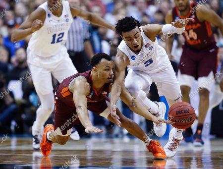 Justin Robinson, Tre Jones. Duke guard Tre Jones (3) loses the ball as he runs into Virginia Tech guard Justin Robinson during the first half of an NCAA men's college basketball tournament East Region semifinal in Washington