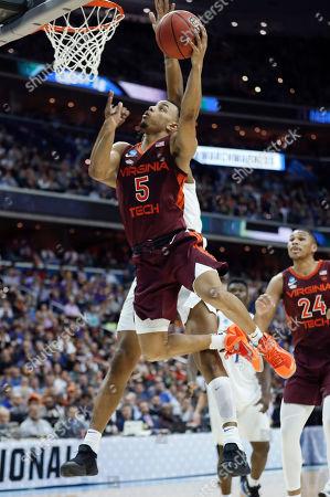 Justin Robinson, Marques Bolden. Virginia Tech guard Justin Robinson (5) scores on Duke center Marques Bolden during the second half of an NCAA men's college basketball tournament East Region semifinal in Washington