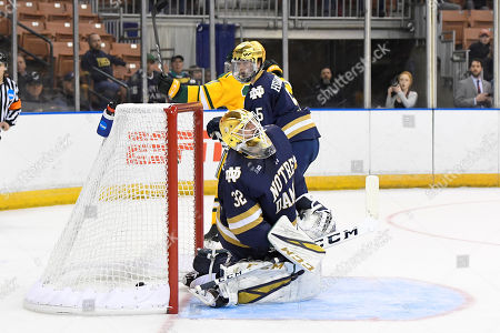 Notre Dame Fighting Irish goaltender Cale Morris (32) reacts to letting the puck in the net during the NCAA Northeast Regional ice hockey tournament game between the Clarkson Golden Knights and the Notre Dame Fighting Irish held at the SNHU Arena in Manchester NH. Notre Dame defeats Clarkson 3-2 in overtime